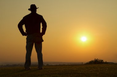 Cowboy gazing into the sunset