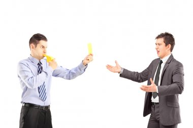 Guy showing yellow card to businessman
