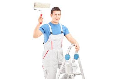 Painter holding roller on ladder
