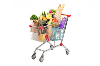 A shopping cart full with various groceries isolated on white background stock vector