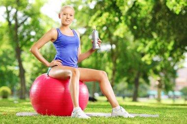 Female athlete on fitness ball