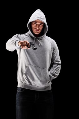 Man holding a gun symbolizing crime