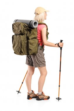 Woman with backpack and hiking poles