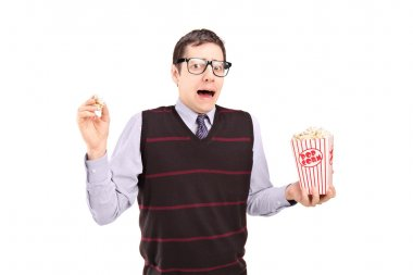 Afraid man holding popcorn box