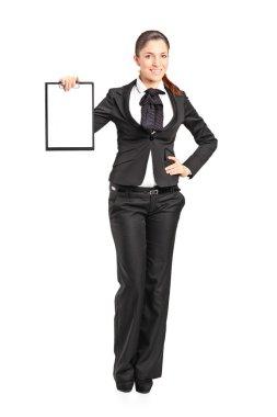 Businesswoman holding an empty clipboard