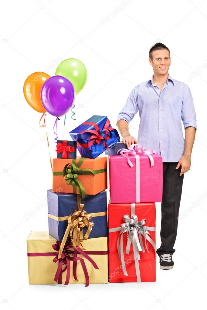 Man next to gifts and balloons