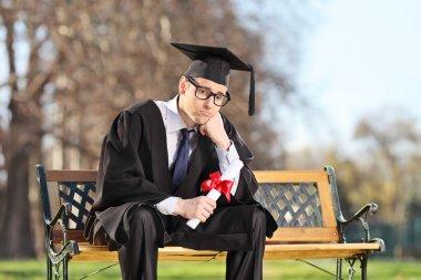 Sad college student in park