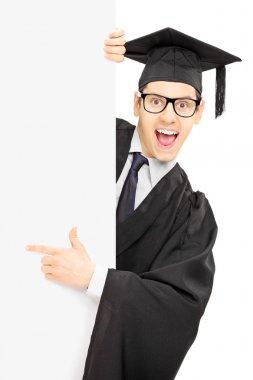 Graduate student behind panel