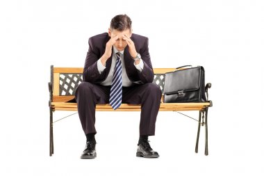 Disappointed businessperson on bench