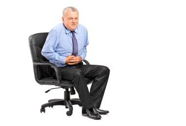 Businessman having stomach ache
