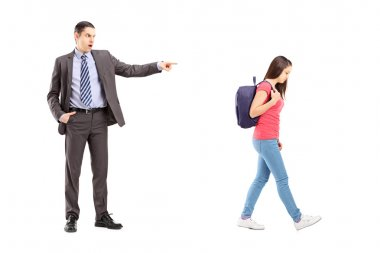 Angry father shouting at daughter