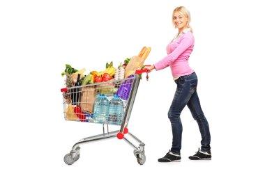 Female pushing shopping cart