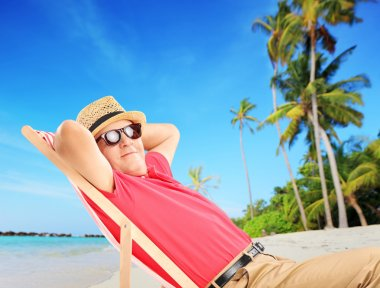 Male tourist enjoying on beach