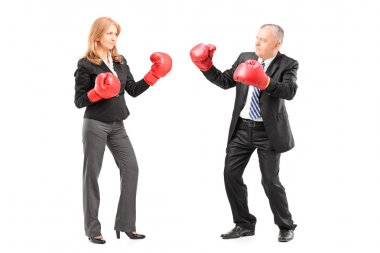businessman and businesswoman with boxing gloves
