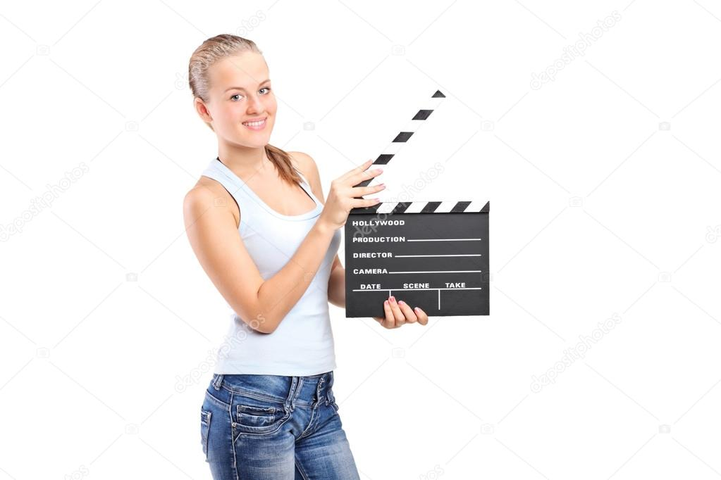 A happy girl holding a movie clap isolated on white background