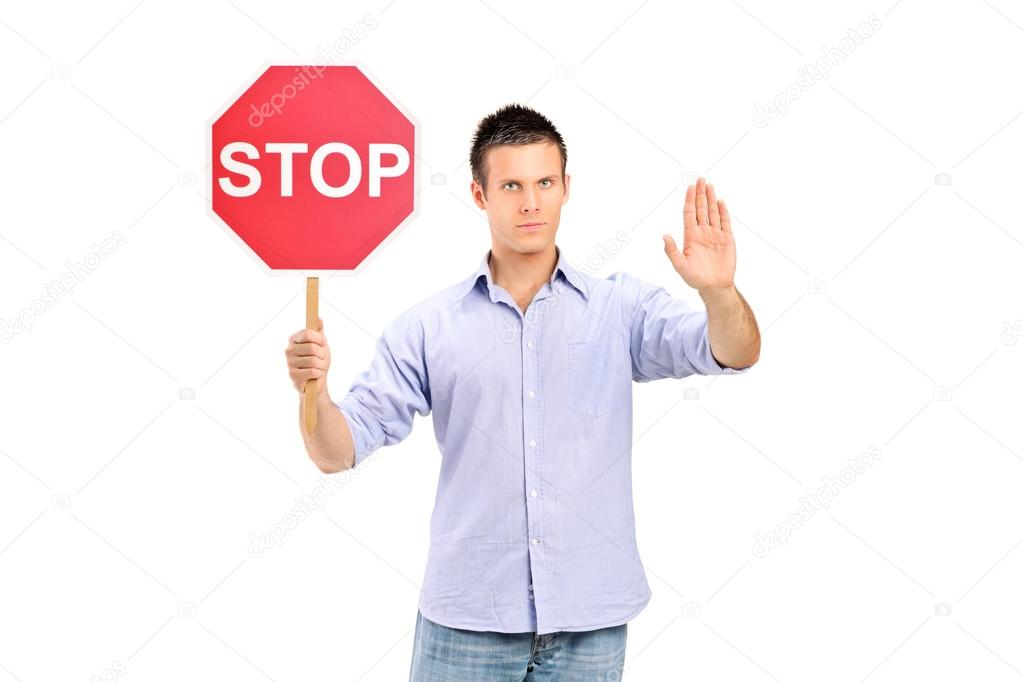 depositphotos_45864491-stock-photo-man-holding-traffic-sign-stop.jpg