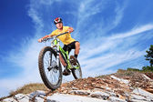 Fotografie Male riding mountain bike