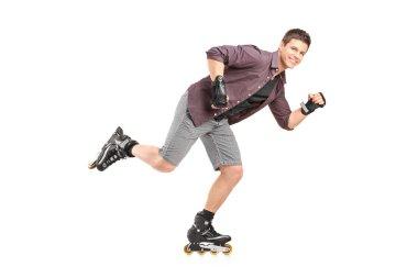 Handsome man roller skating