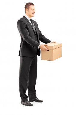 Businessman giving box to someone