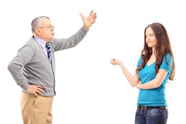Father reprimanding daughter