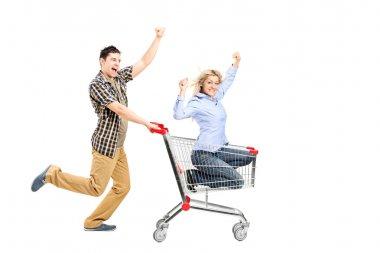 Man pushing woman in shopping bag