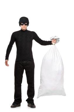 Thief holding bag