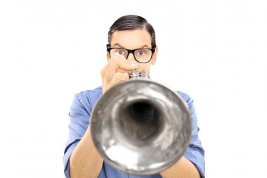Male musician blowing into a trumpet