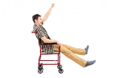 Young man sitting in wheelchair