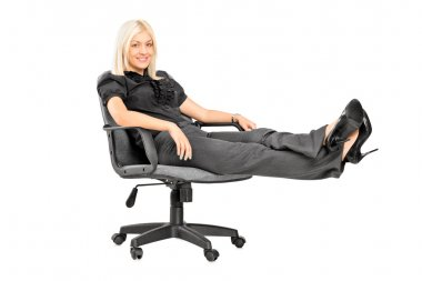 Woman sitting on chair with legs up
