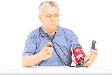 Man measuring blood pressure