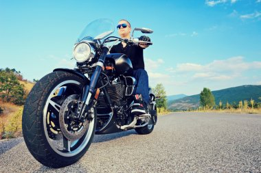 Biker posing on motorcycle