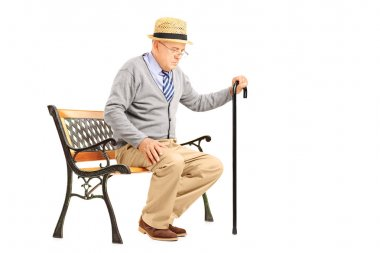 Senior man with a cane on bench