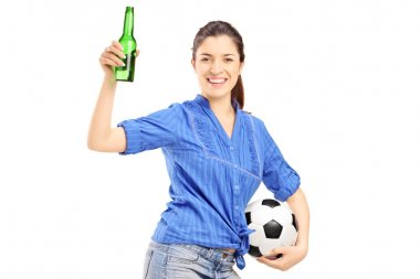 Fan holding beer bottle and soccerball