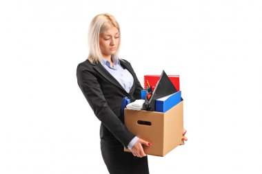 Fired businesswoman carrying box