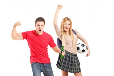 Male and female football supporters cheering