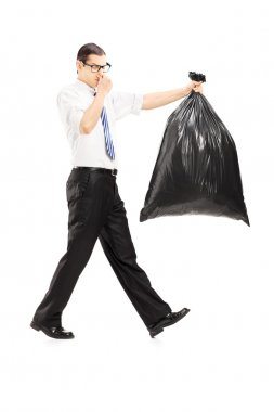 Male carrying stinky garbage bag