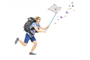 Male tourist catching butterflies with net