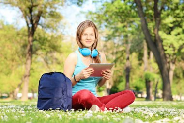 Student with headphones and tablet