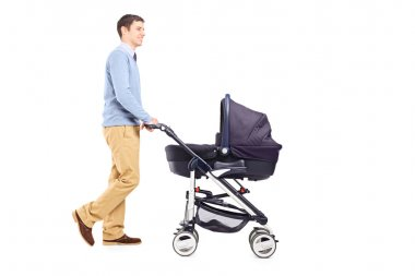 Father pushing baby stroller