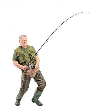 Fisherman holding fishing pole