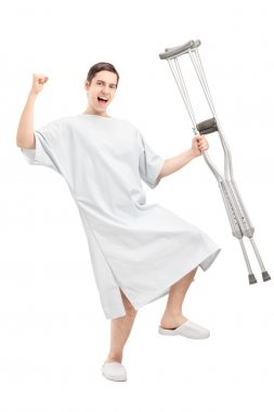 Patient holding crutches