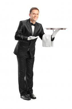Butler holding an empty tray