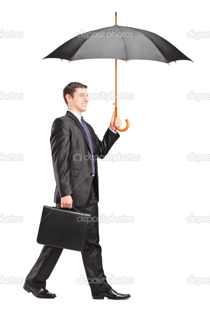 man holding an umbrella and briefcase stock photo ljsphotography
