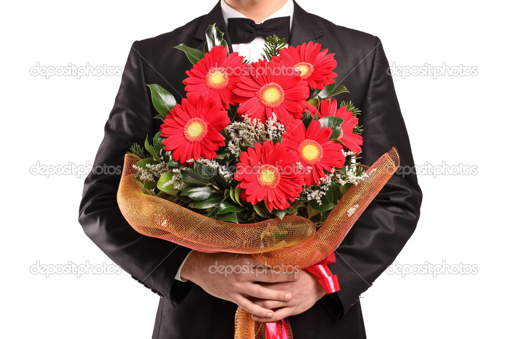 A man holding a large bouquet of flowers — Stock Photo ...