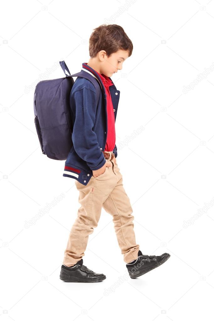 Sad school boy walking