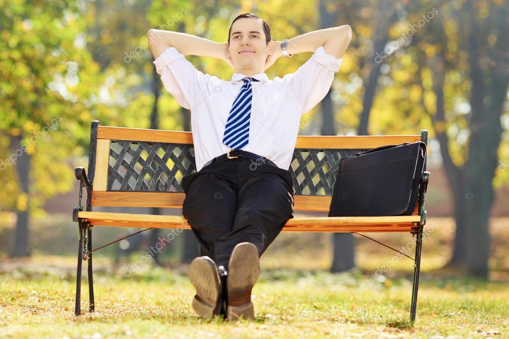 Relaxed businessman in park