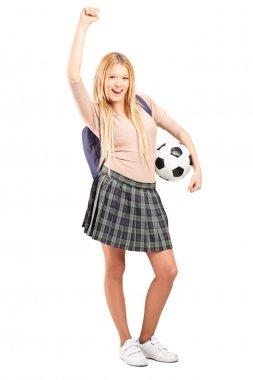 Student holding soccer ball