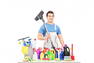 Male cleaner with cleaning supplies