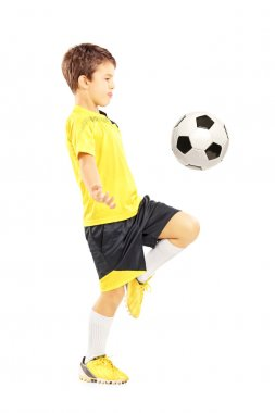 Child joggling with soccer ball