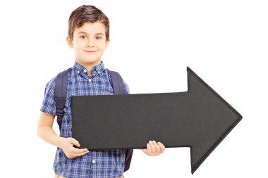 Boy holding arrow